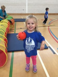 little girl playing in a gym
